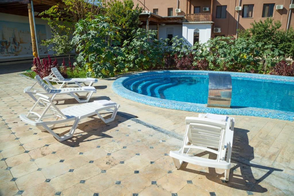 The swimming pool at or close to Avicenna Hotel