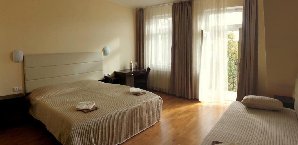 Letto o letti in una camera di Hotel Trevi