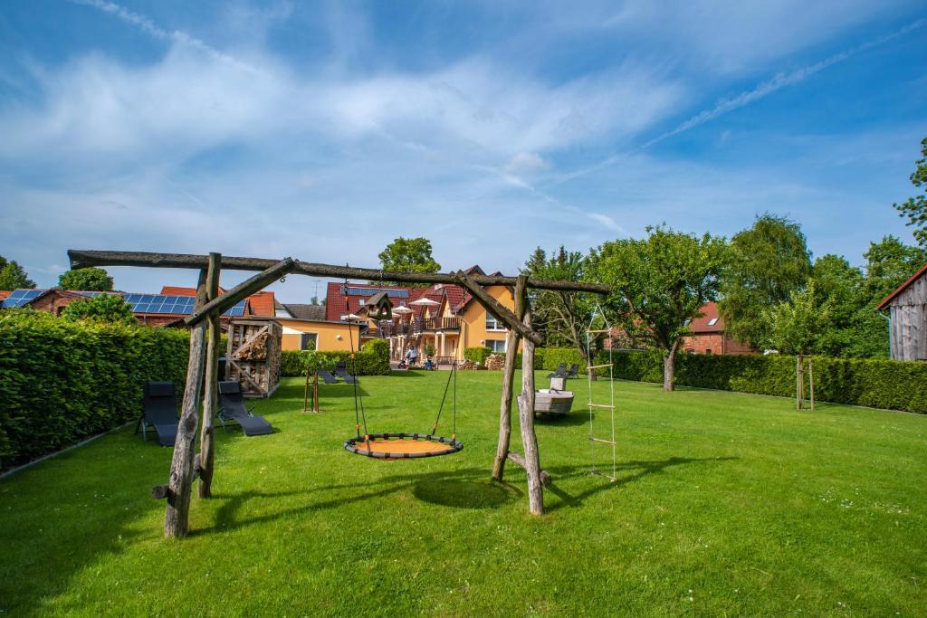 Children's play area at Ferienappartements Am Spreewaldfliess