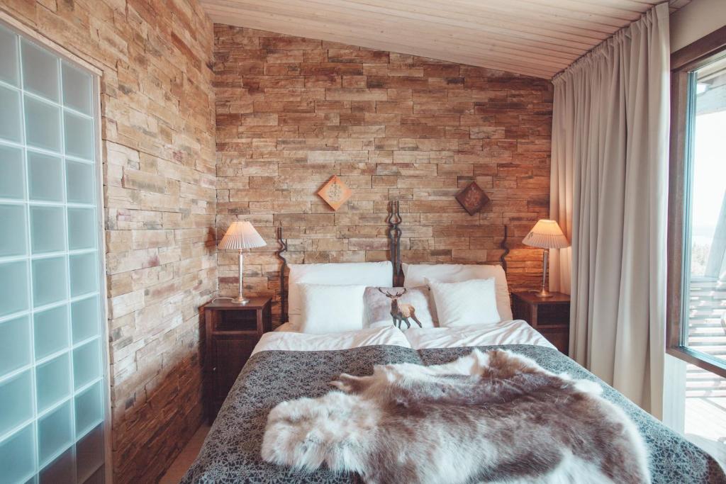 Lova arba lovos apgyvendinimo įstaigoje Ruka Peak - Boutique Hotel & Restaurant