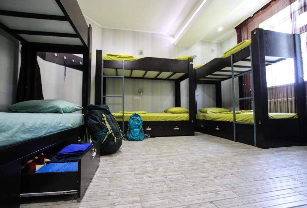 A bunk bed or bunk beds in a room at Apple Hostel Bishkek