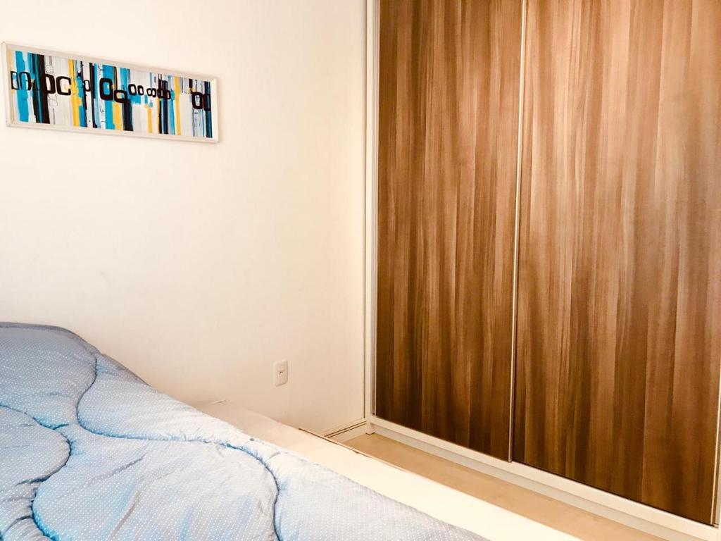 Cama ou camas em um quarto em Lindo Apartamento, canela