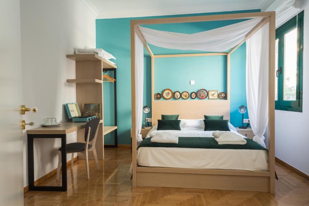 A bed or beds in a room at Neratzia Rooms