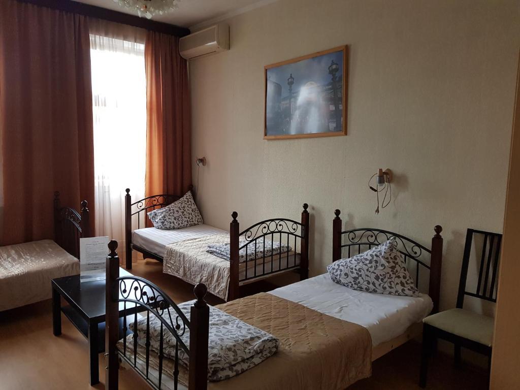 Cama o camas de una habitación en Mini-Hotel Versal na Brestskoy