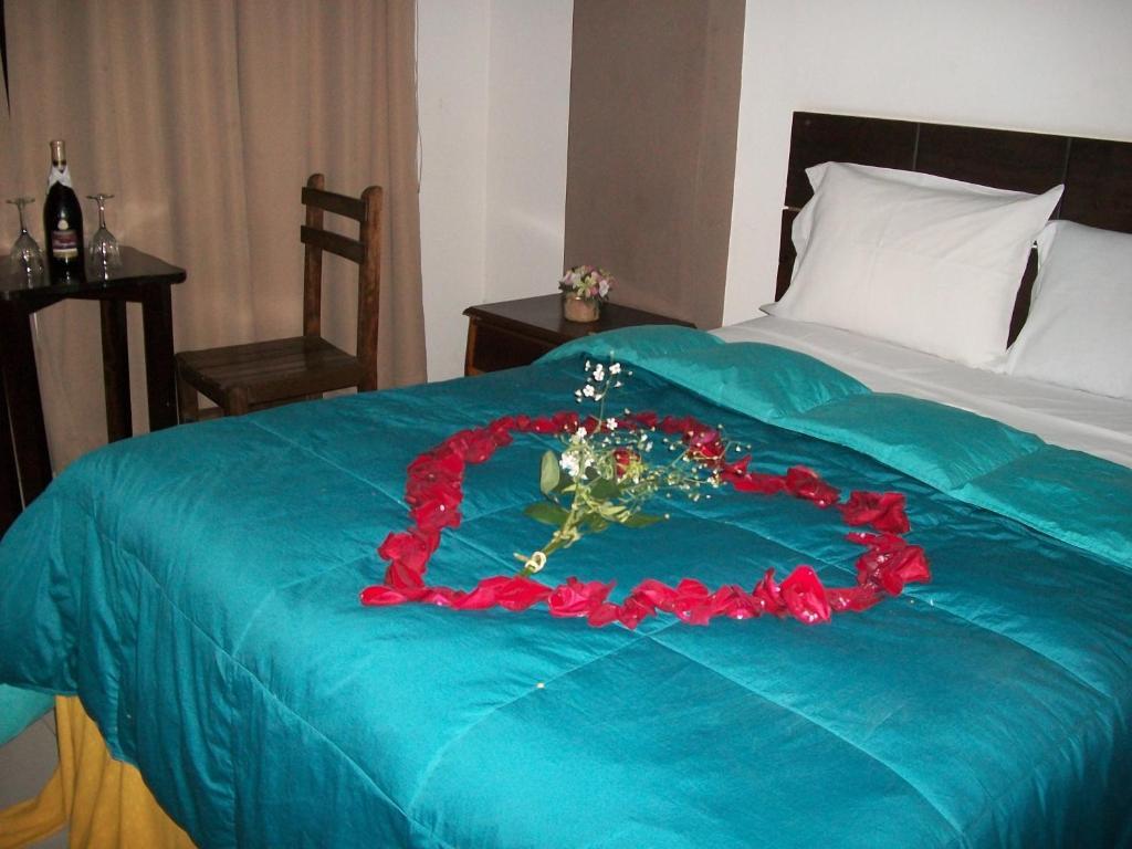 Cama o camas de una habitación en Suites El Parque