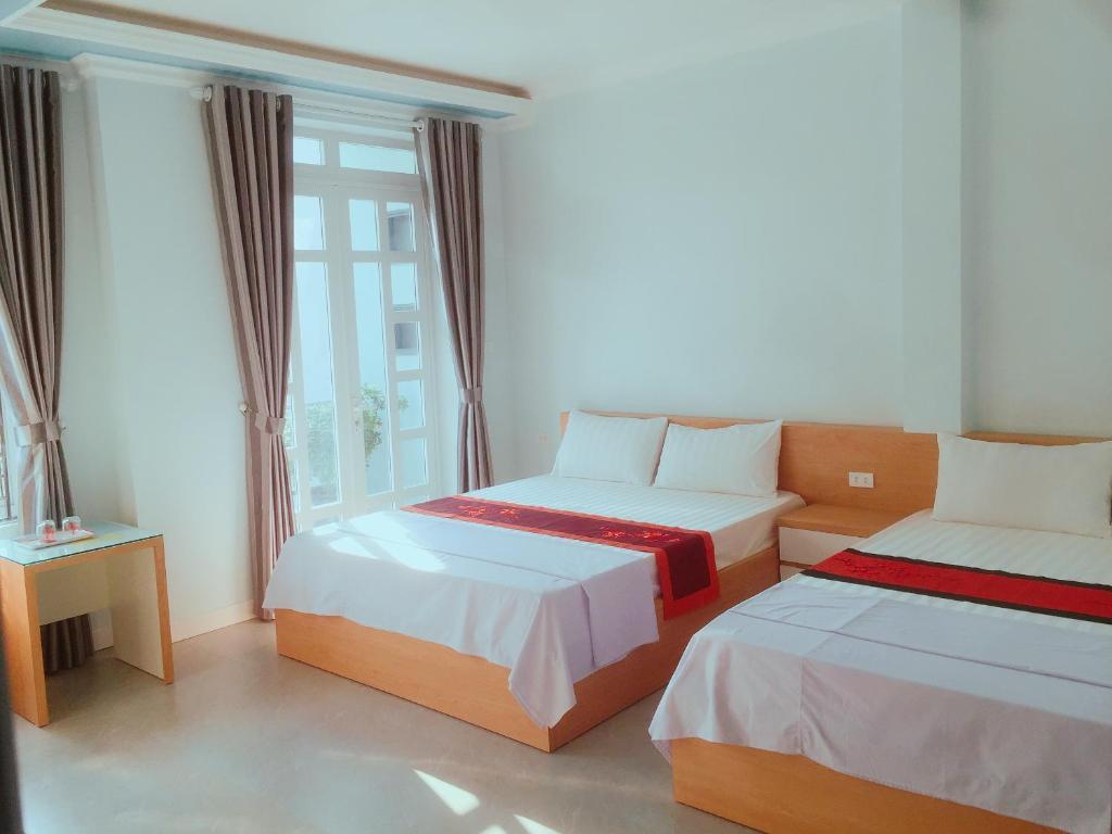 Postel nebo postele na pokoji v ubytování Cat Ba Central Homestay