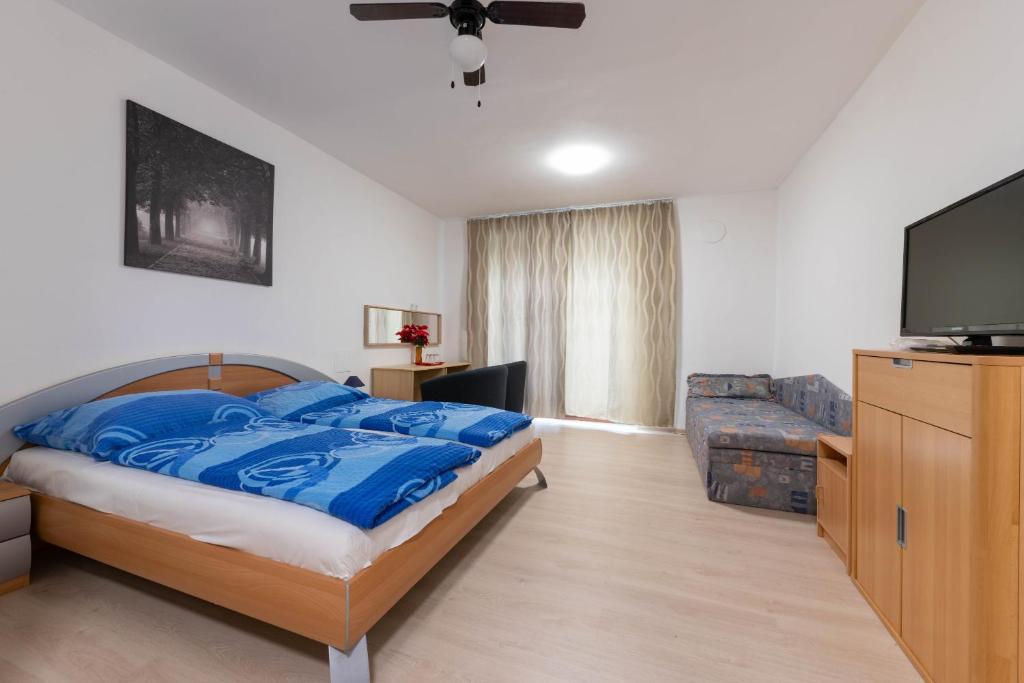 Ένα ή περισσότερα κρεβάτια σε δωμάτιο στο Penzión Vilo