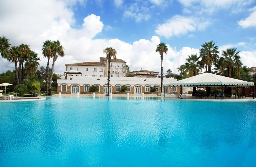 The swimming pool at or near iH Hotels Agrigento Kaos Resort