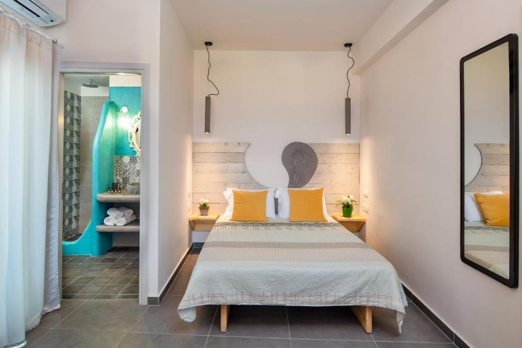 A bed or beds in a room at Afrodete Hotel