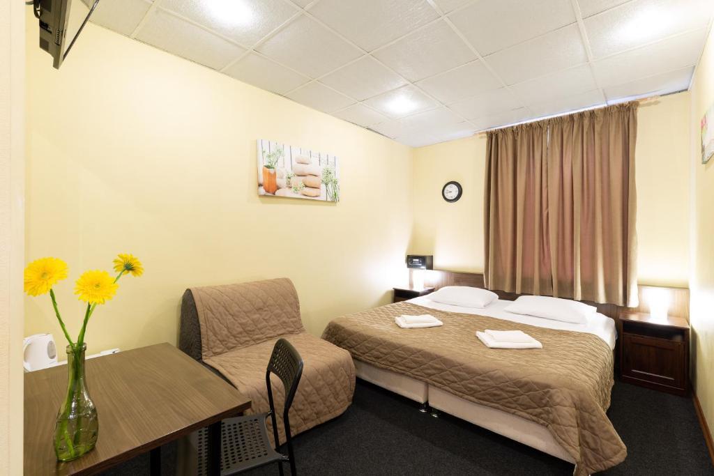 Ein Bett oder Betten in einem Zimmer der Unterkunft Mini-Hotel Entrance N2
