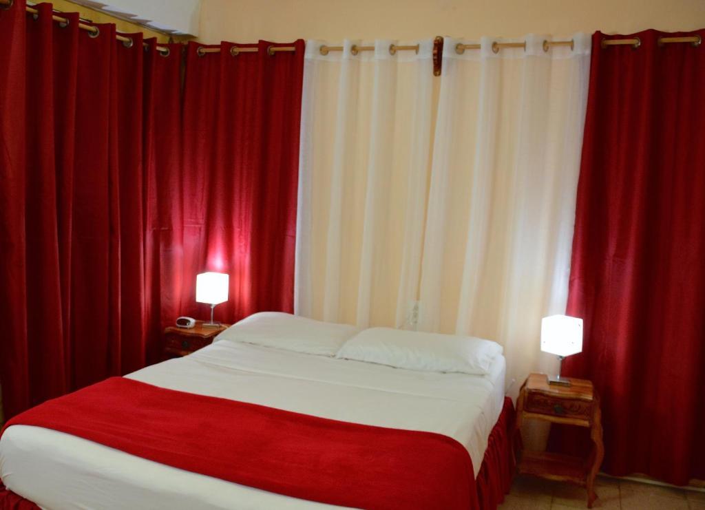 Cama o camas de una habitación en Valia Vacation Apartment