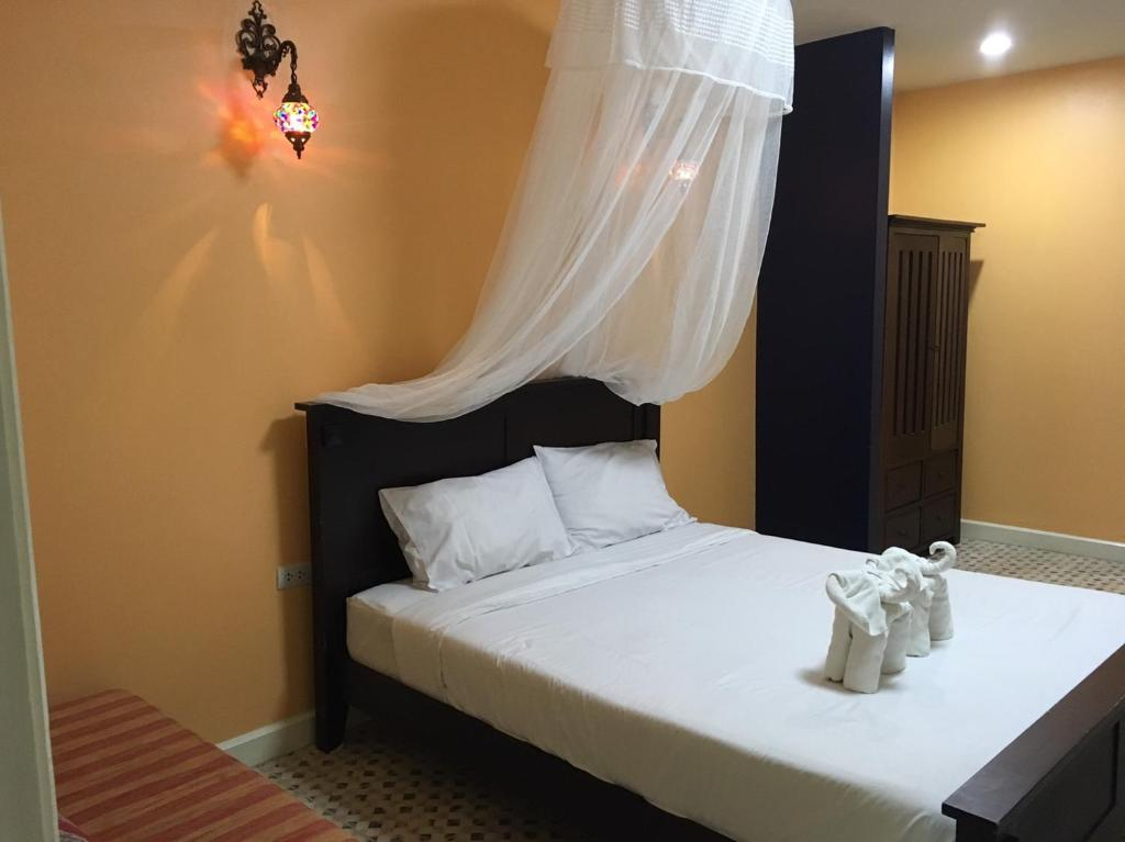 A bed or beds in a room at Chayayon Hotel