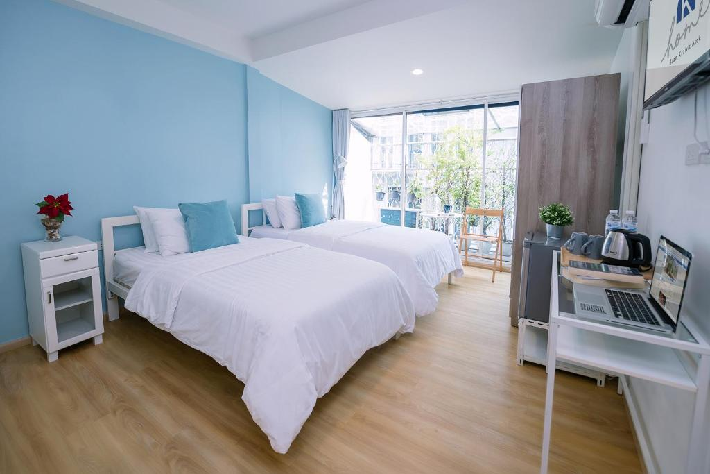 A bed or beds in a room at K Home Asok