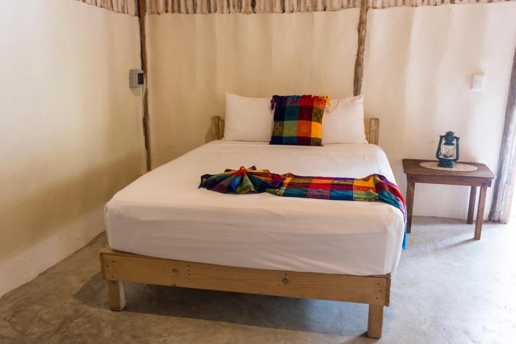 Un ou plusieurs lits dans un hébergement de l'établissement Siete Deseos