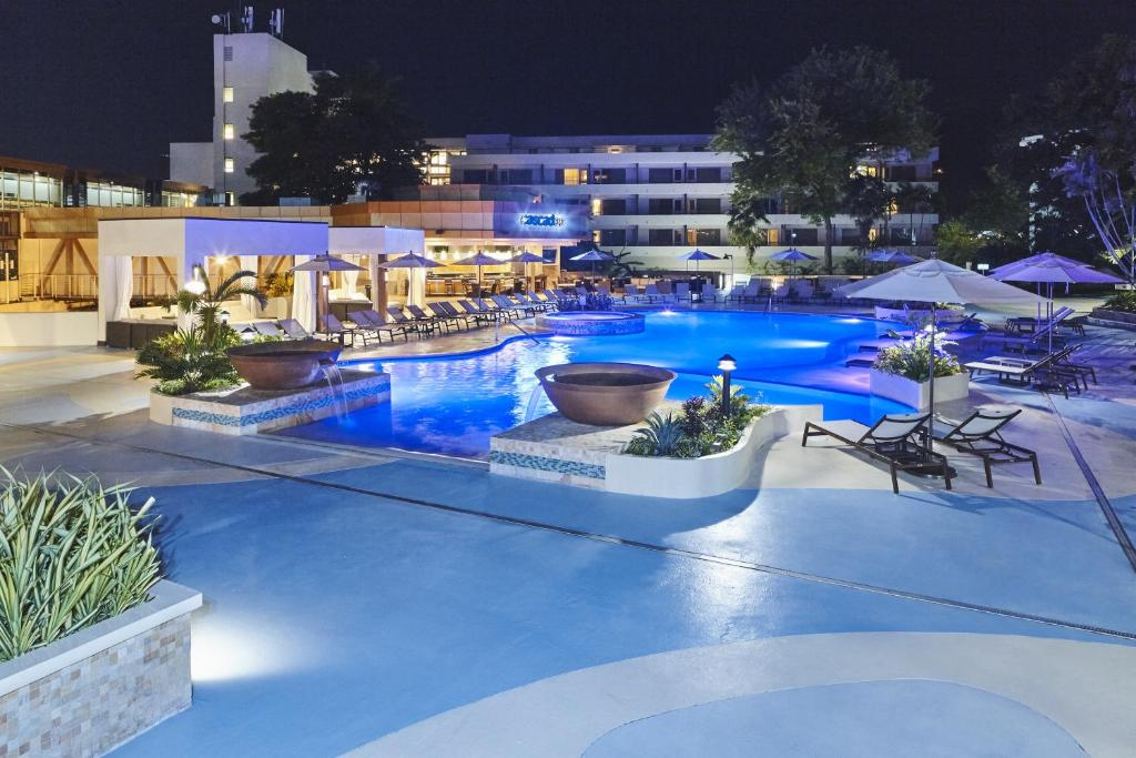 The swimming pool at or near Hilton Trinidad & Conference Centre