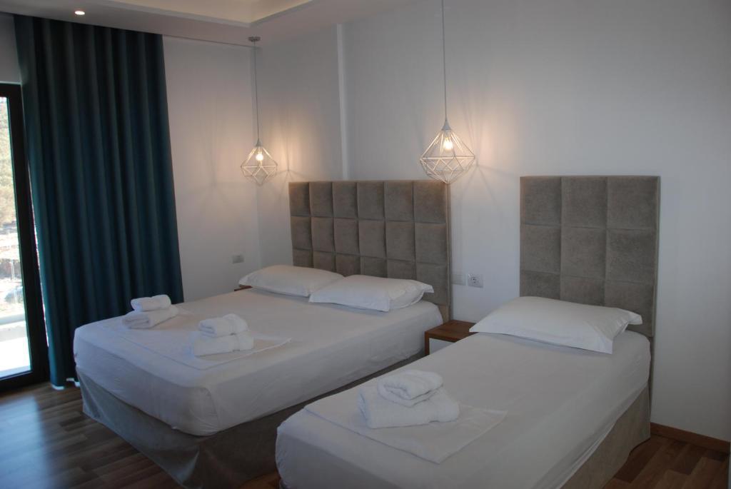 Кровать или кровати в номере Bianco Hotel