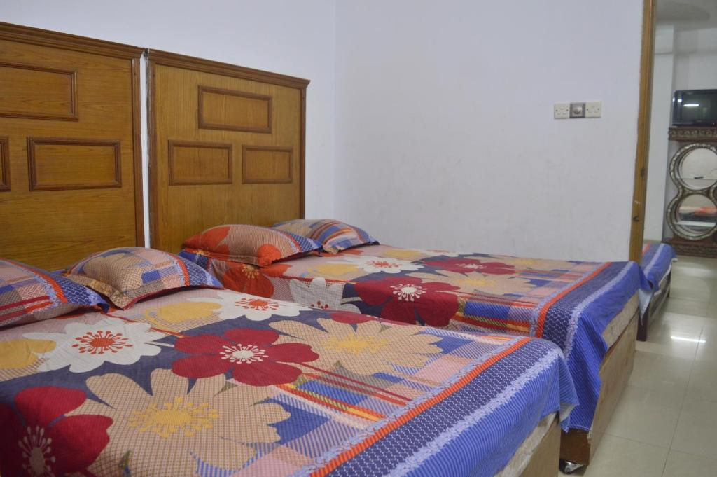 A bed or beds in a room at Sea View Apartment