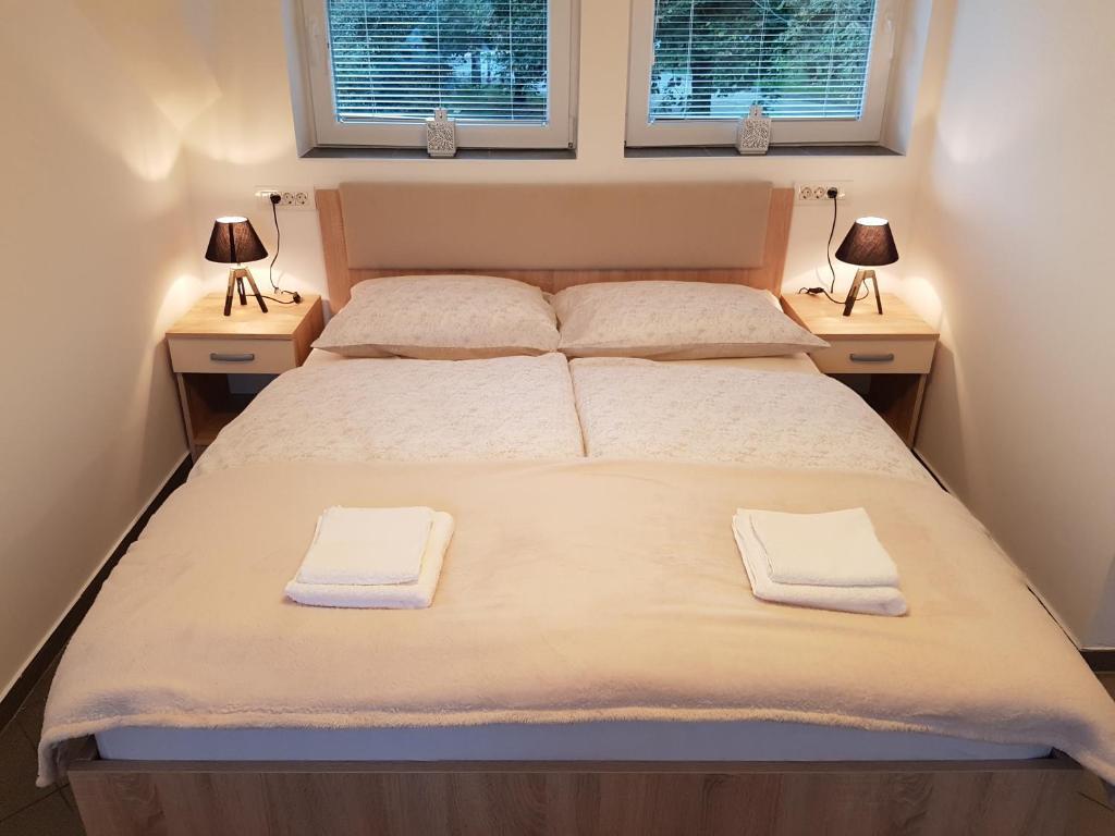 Postelja oz. postelje v sobi nastanitve 4 seasons apartment Radovljica
