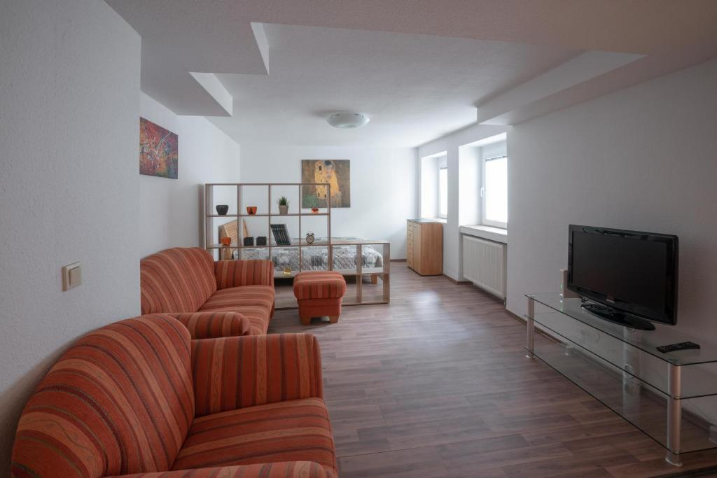 A seating area at Apartment am Grafenberger Wald