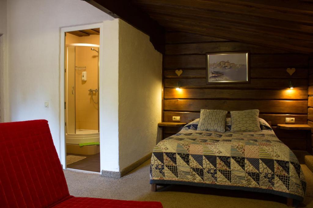 Кровать или кровати в номере Отель Рай-Ski-Домик