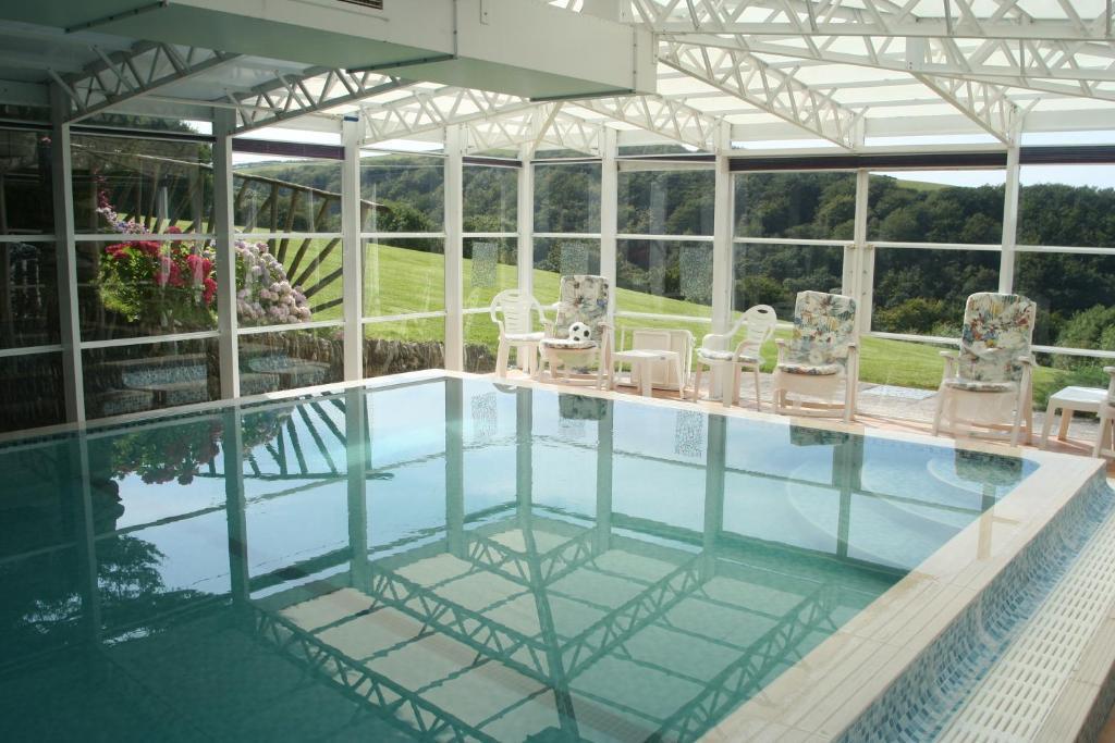 The swimming pool at or near Wilsham Farm