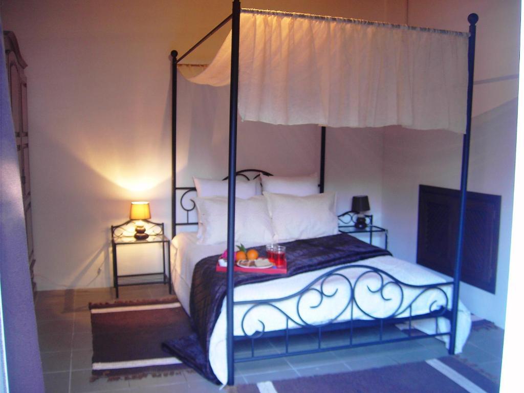 A bed or beds in a room at Casa da Penalva