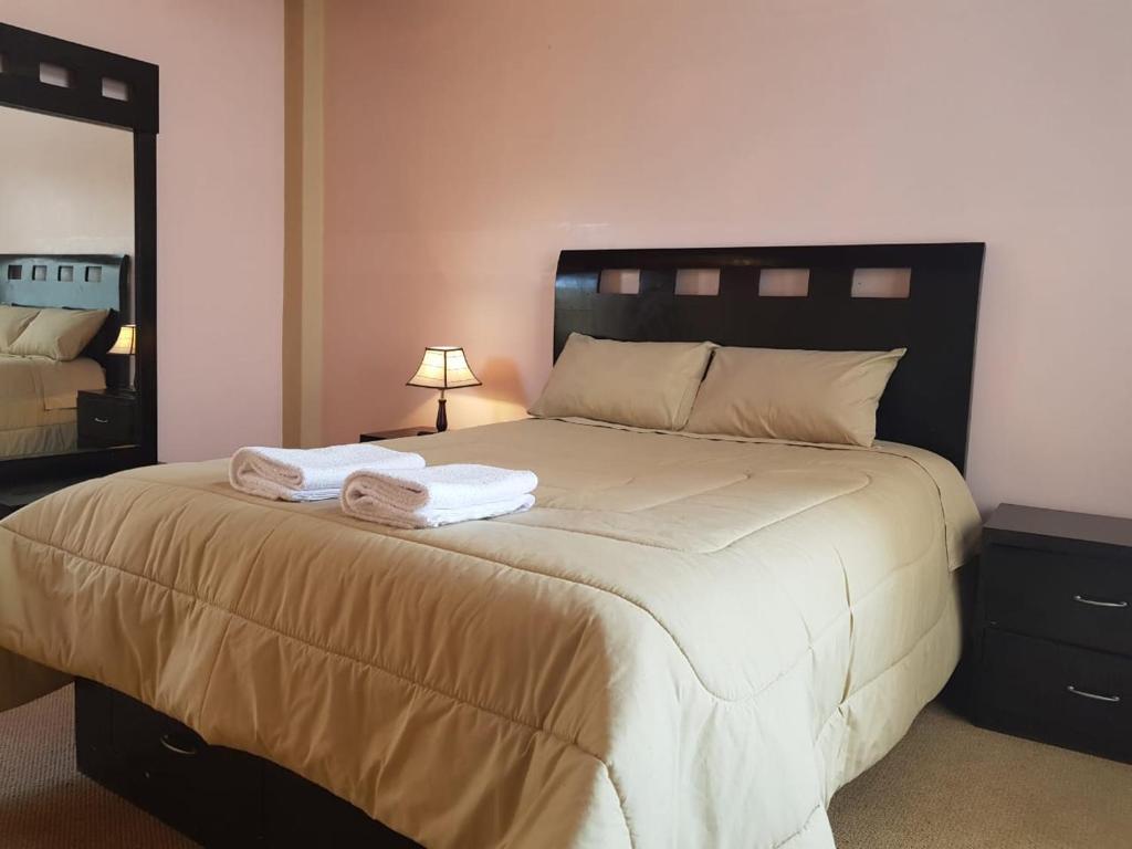 Cama o camas de una habitación en Cusco holiday apartments