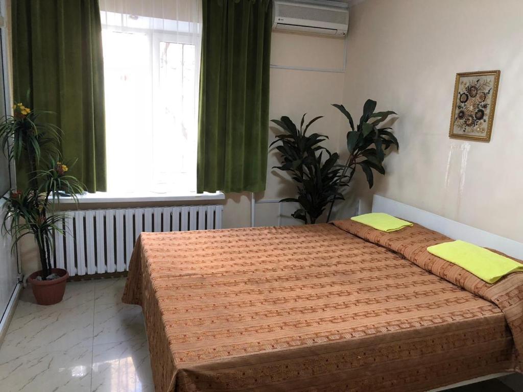 Кровать или кровати в номере Elite Hostel