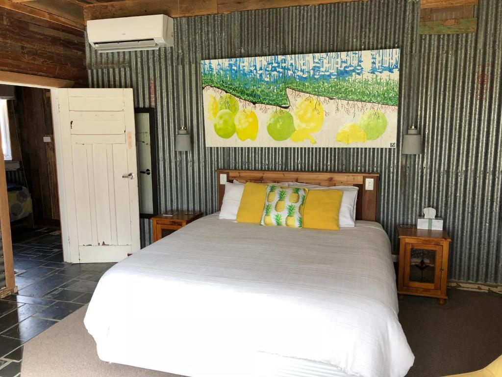 A bed or beds in a room at Bed in a Shed Vineyard Stay