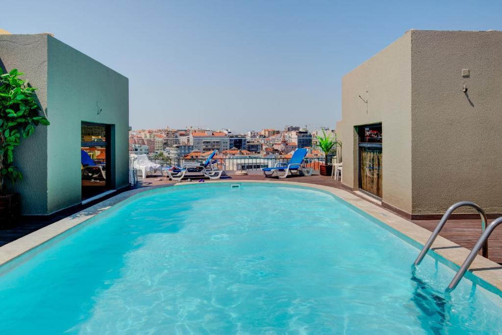 The swimming pool at or near VIP Executive Marques Aparthotel