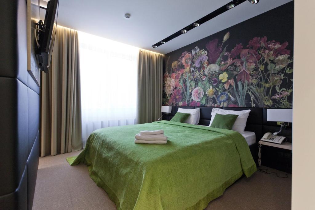 Кровать или кровати в номере Арт Отель