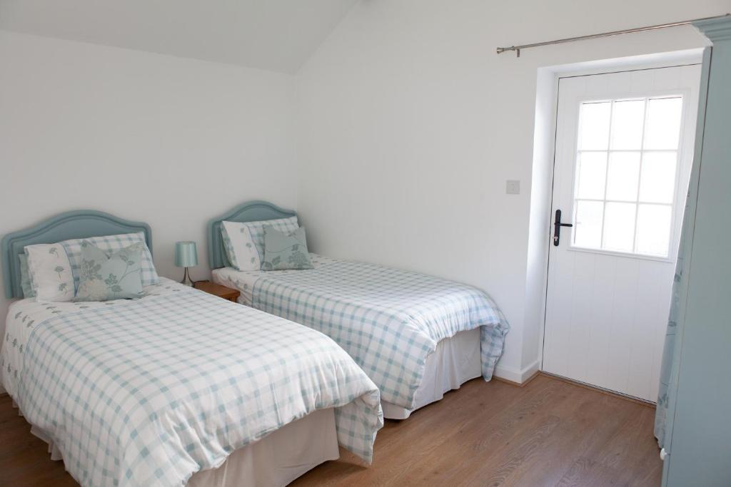 Krevet ili kreveti u jedinici u objektu Elm Cottage Touring Park