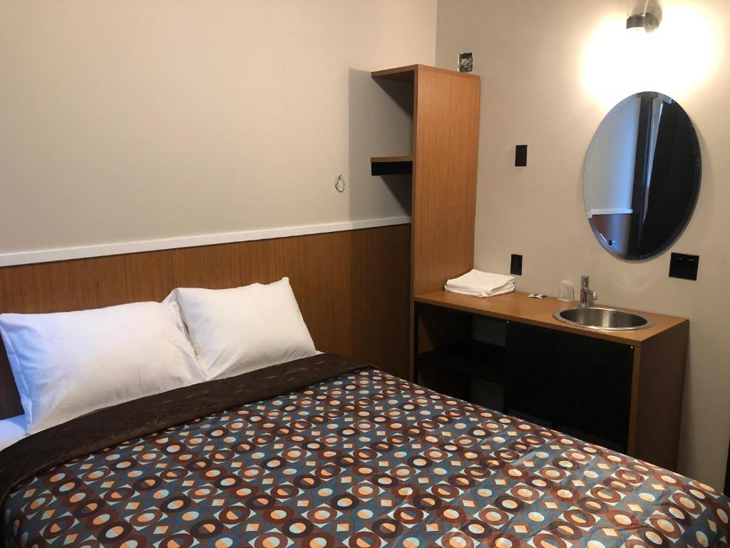 A bed or beds in a room at Europa Hostel
