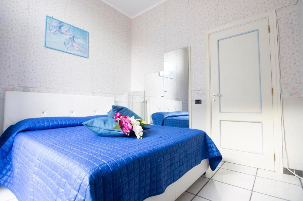 A bed or beds in a room at La casa del capitano