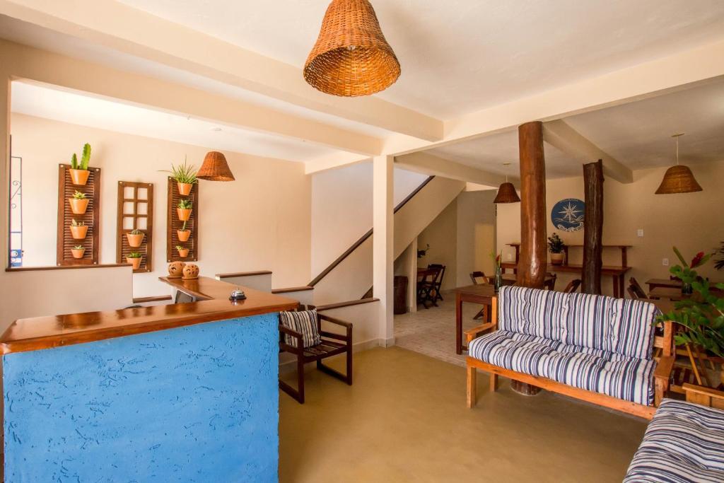 Uma área de estar em Pousada Ilha do Encanto