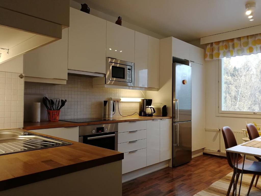 Majoituspaikan Scandinavian Sun Apartments keittiö tai keittotila