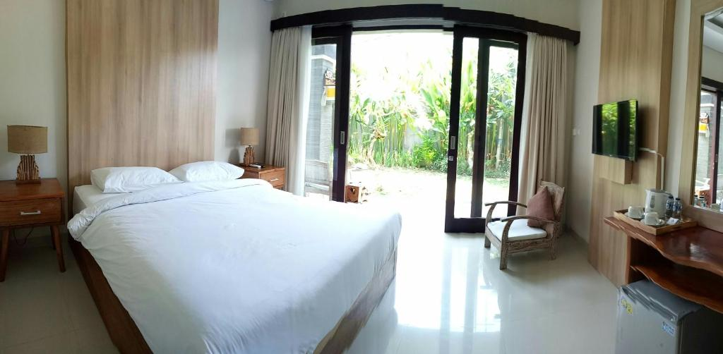 A bed or beds in a room at Guest House Reisya