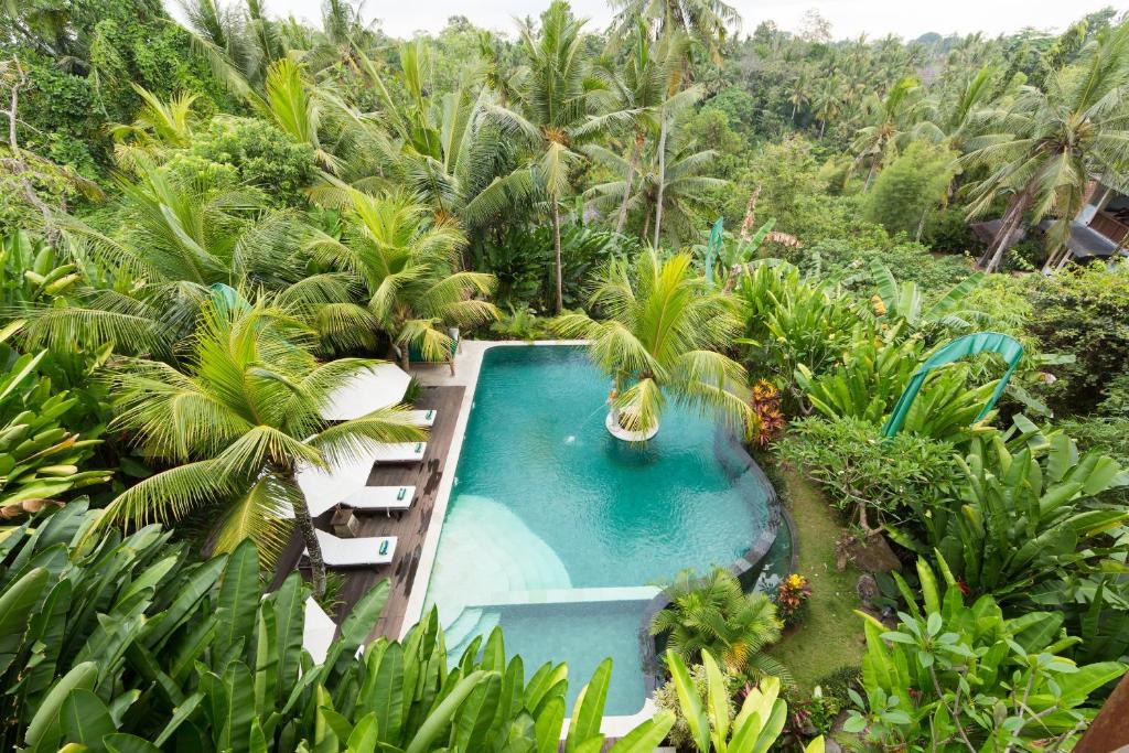 A view of the pool at Alamdini Resort Ubud or nearby
