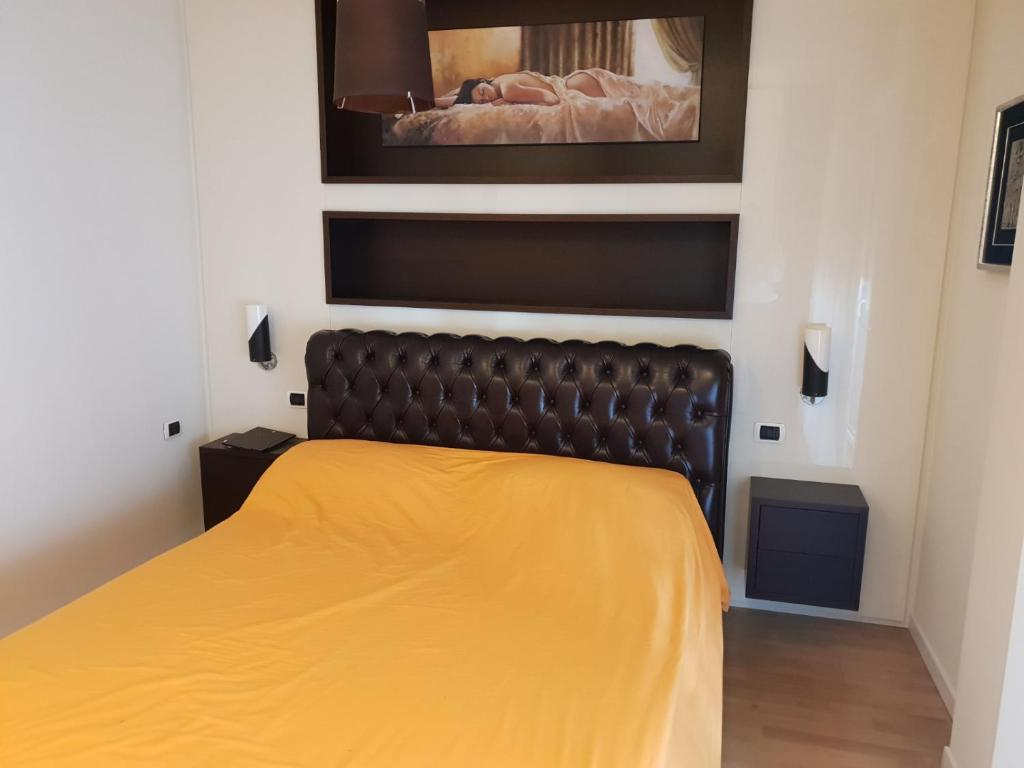 A bed or beds in a room at appartamento melotti - palazzo sky