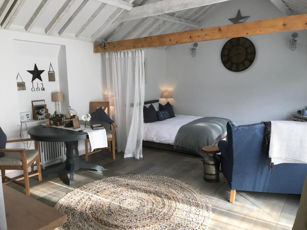 A bed or beds in a room at Crafts Hill Barn
