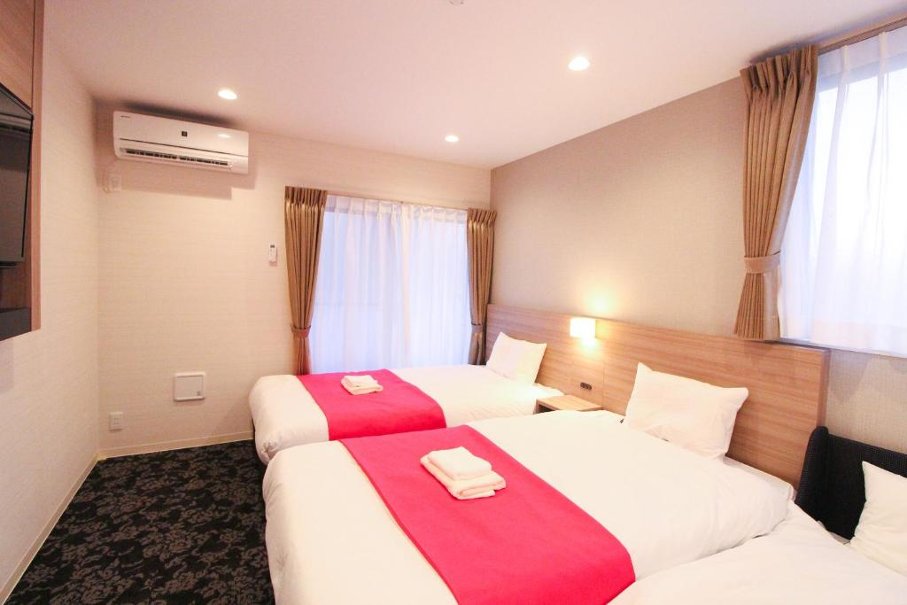 A bed or beds in a room at M-1 Tokyo Minamikamata