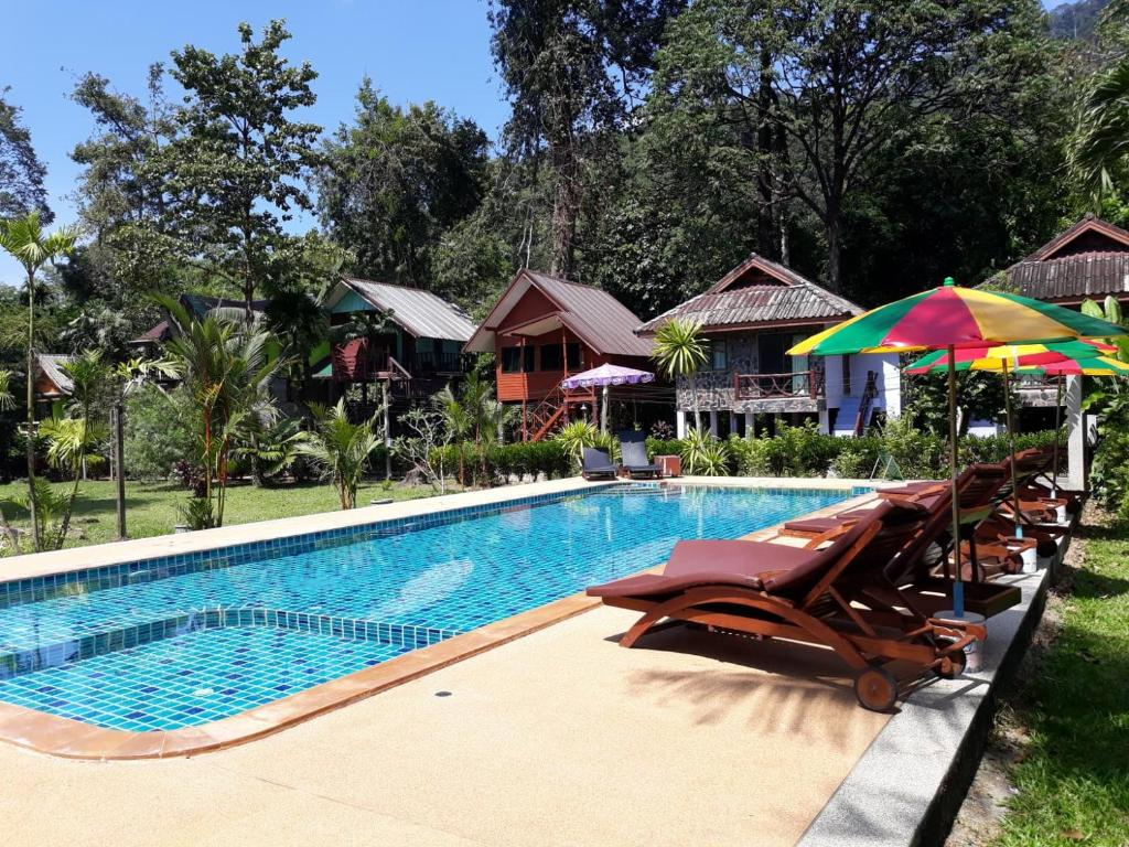The swimming pool at or near Tree Tops River Huts