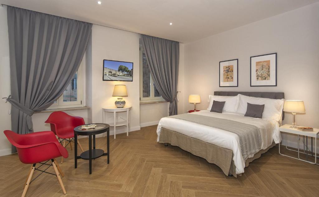 Un ou plusieurs lits dans un hébergement de l'établissement Il Giardino Dei Semplici