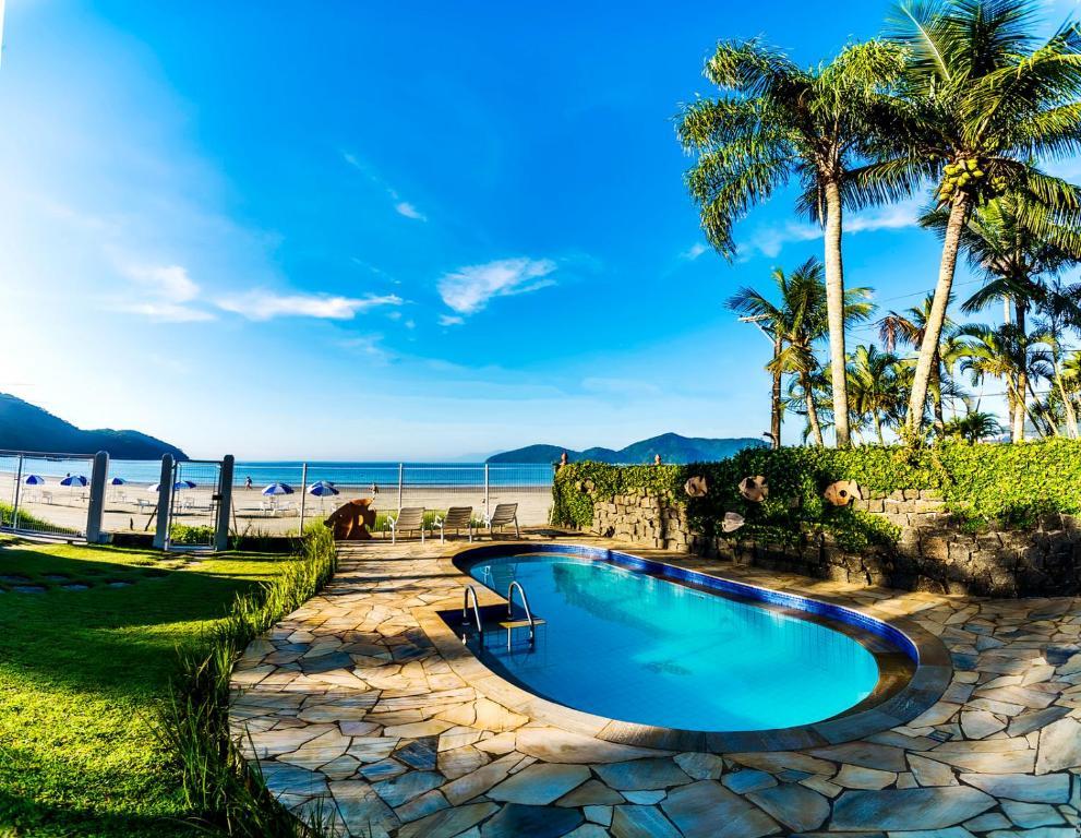 A piscina localizada em Areia do Mar Pousada ou nos arredores