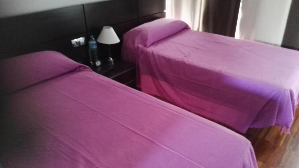 A bed or beds in a room at albergue rural vía de la plata