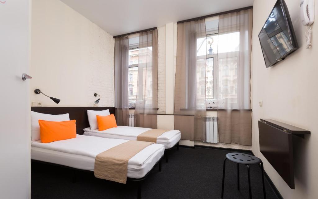 Cama o camas de una habitación en Station Hotel M19