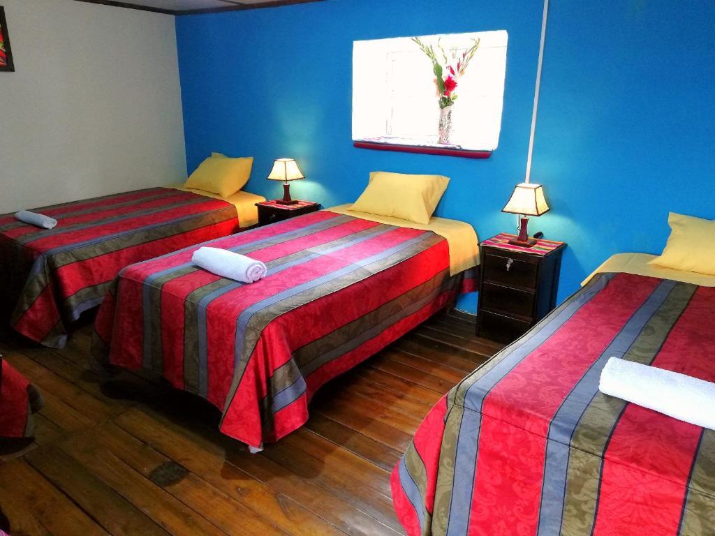 Cama o camas de una habitación en El corazón del Cusco