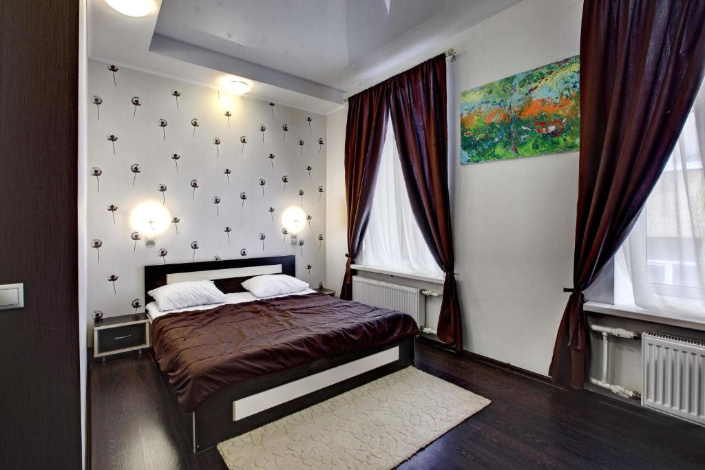 A bed or beds in a room at RA Ligovskiy 87