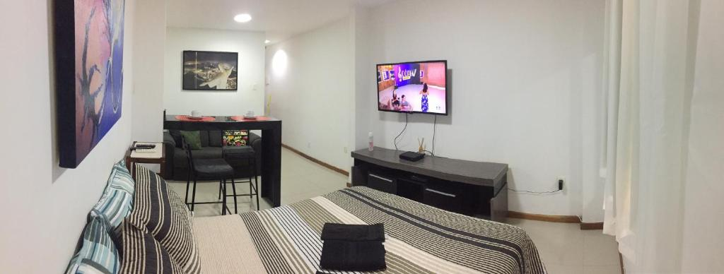 A television and/or entertainment center at Studio Botafogo Beach