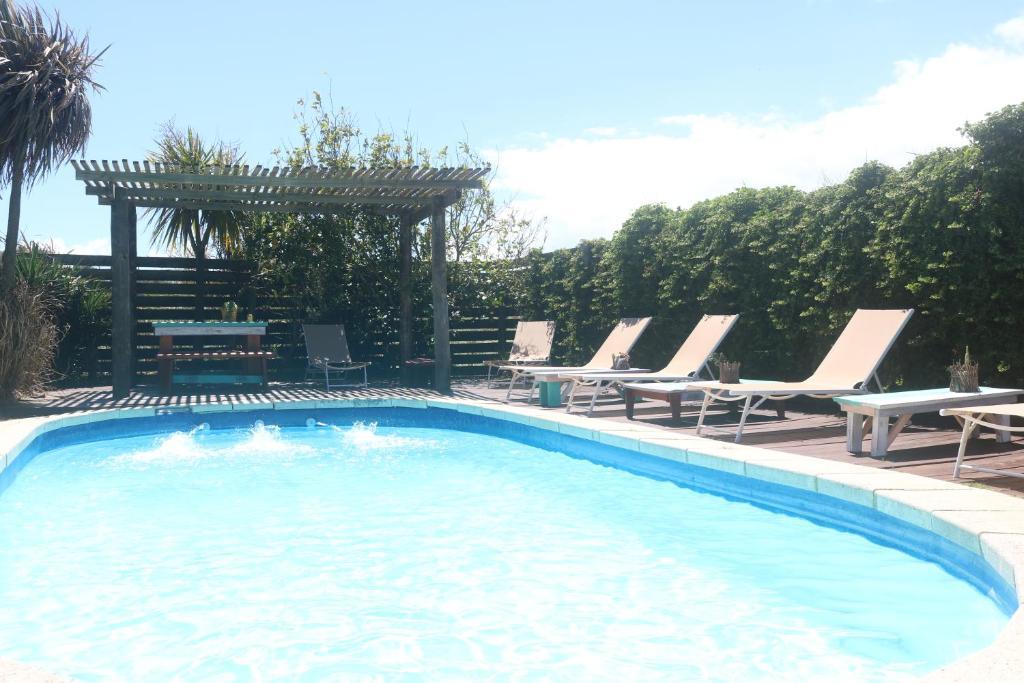 The swimming pool at or near Posada de la Viuda